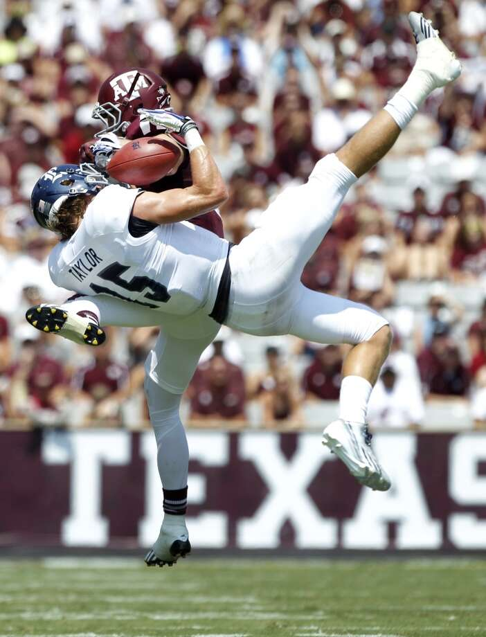 Rice wide receiver Jordan Taylor (15) pulls down a reception with Texas A&M defensive back Clay Honeycutt (25) defending during the first quarter of an NCAA college football game at Kyle Field Saturday, Aug. 31, 2013, in College Station. ( Brett Coomer / Houston Chronicle ) Photo: Brett Coomer, Houston Chronicle