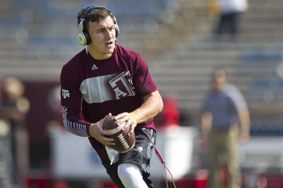 Texas A&M quarterback Johnny Manziel warms up before the Aggies' NCAA college football game against Rice at Kyle Field Saturday, Aug. 31, 2013, in College Station. ( Brett Coomer / Houston Chronicle ) Photo: Brett Coomer, Houston Chronicle