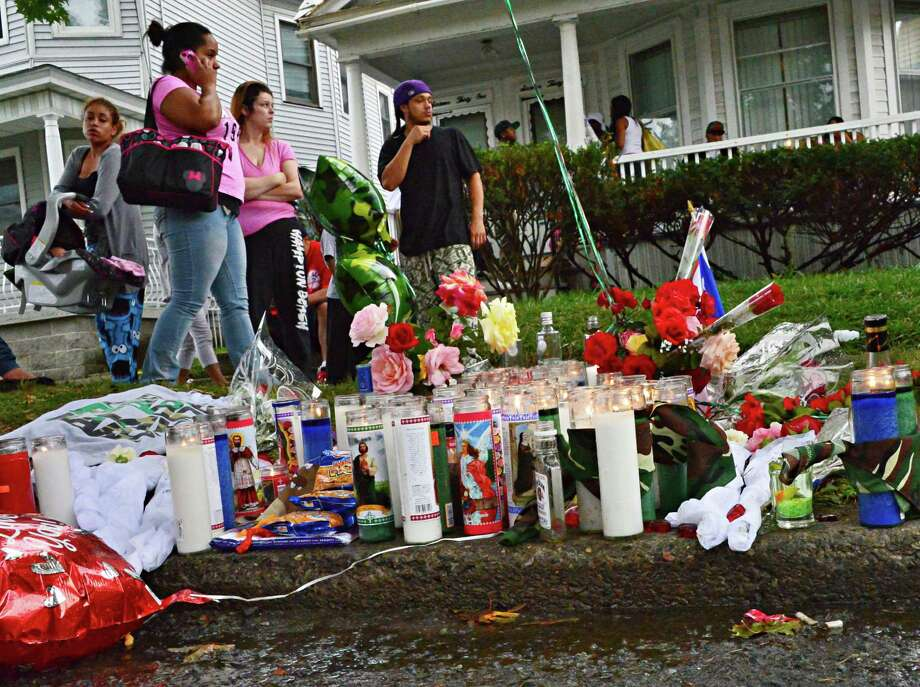 Mourners and a memorial outside 1633 Becker St. Saturday August 31, 2013, scene of last night's double shooting in Schenectady, NY.  (John Carl D'Annibale / Times Union archive) Photo: John Carl D'Annibale / 00023724A