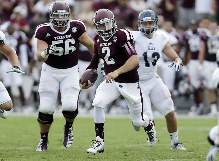 Texas A&M quarterback Johnny Manziel (2) scrambles during the third quarter against Rice in College Station, Texas. Photo: Eric Gay, Associated Press