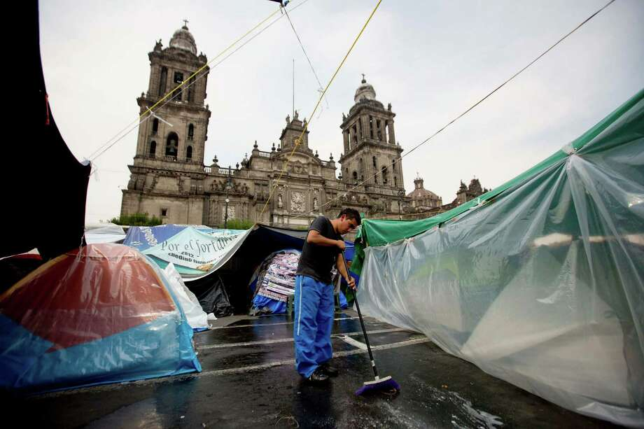 A tent city set up by protesting schoolteachers in Mexico City's main Zocalo plaza has snarled traffic, blocked government buildings and shut down sports events. Photo: Eduardo Verdugo, STF / AP
