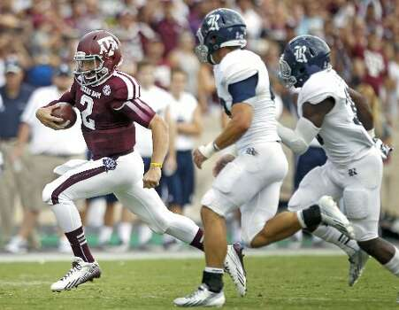 Texas A&M quarterback Johnny Manziel scrambles against Rice. Photo: Brett Coomer, Houston Chronicle