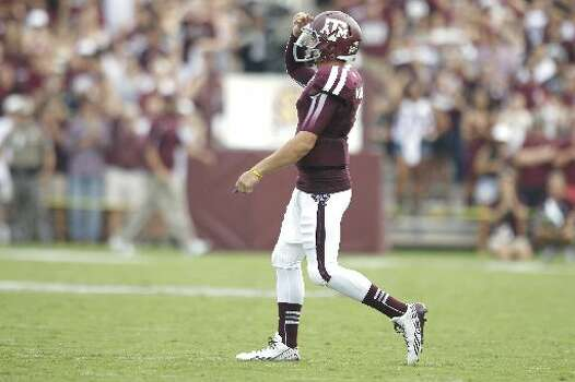 Texas A&M quarterback Johnny Manziel celebrates a touchdown. Photo: Brett Coomer, Houston Chronicle
