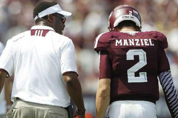 Texas A&M coach Kevin Sumlin speaks with quarterback Johnny Manziel.