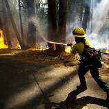 Colorado Rural Protection firefighter Molly McGee fights the Rim Fire in the Stanislaus National Forest in California, Thursday, August 22, 2013.