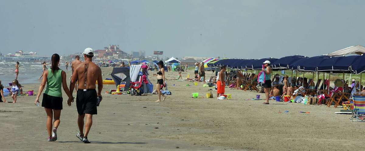 Crowds gather on the beach near Beach Town Saturday, Aug. 31, 2013, in Galveston.