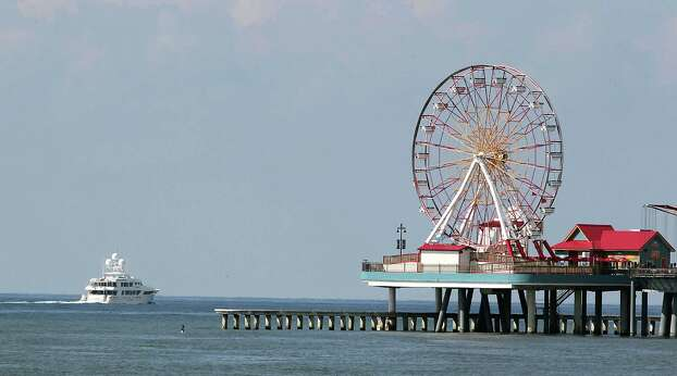 Tilman Fertitta's yacht Boardwalk motors along the Galveston beachfront near the Galveston Island Historic Pleasure Pier Saturday, Aug. 31, 2013, in Galveston. Photo: James Nielsen, Houston Chronicle / © 2013  Houston Chronicle