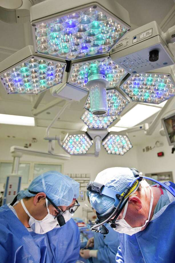 Charles D. Fraser, Jr., M.D. Texas Children's Hospital's surgeon in chief, in the operating room in Texas Children's Hospital in Houston. Photo: Nick De La Torre, Houston Chronicle / © 2013  Houston Chronicle