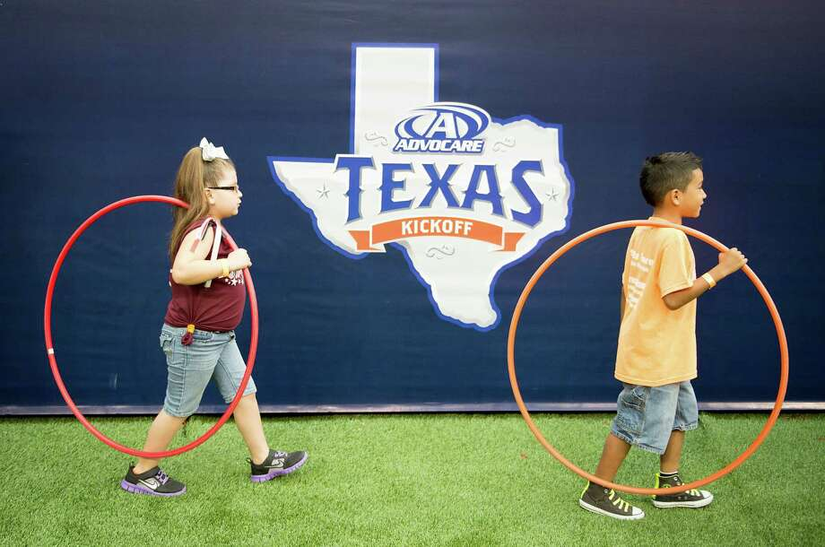 Alvin ISD (bond approved in November 2013)Bond amount: $212.5 millionTax increase: YesPictured: Members of the  Alvin ISD R.L. Stevenson Primary School Hula Hoop Team prepare to perform at halftime of the AdvoCare Texas Kickoff college football game between Oklahoma State and Mississippi State at Reliant Stadium, Aug. 31, 2013, in Houston. Photo: Smiley N. Pool, Houston Chronicle / © 2013  Houston Chronicle