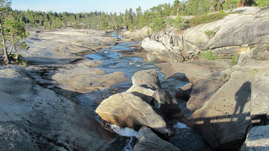From Lake Vernon, Falls Creeks runs across the granite slabs and eventually feeds into Wapama Falls at Hetch Hetchy Photo: Michael Furniss/Wild Earth Press, Picasa