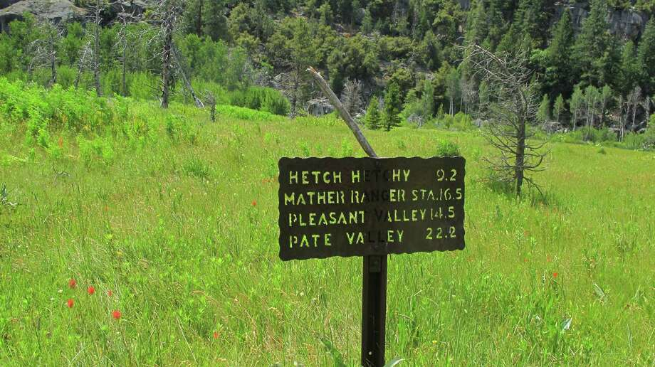 A vintage sign in lush Tiltill Valley points the way onward to Hetch Hetchy Photo: Michael Furniss/Wild Earth Press, Picasa