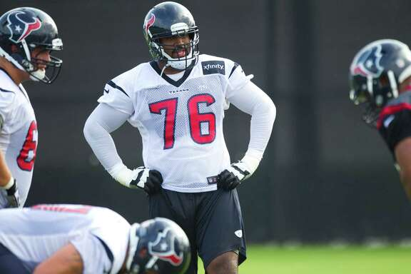 Houston Texans tackle Duane Brown (76) watches a drill during Texans training camp at the Methodist Training Center Saturday, July 27, 2013, in Houston.  ( Brett Coomer / Houston Chronicle )