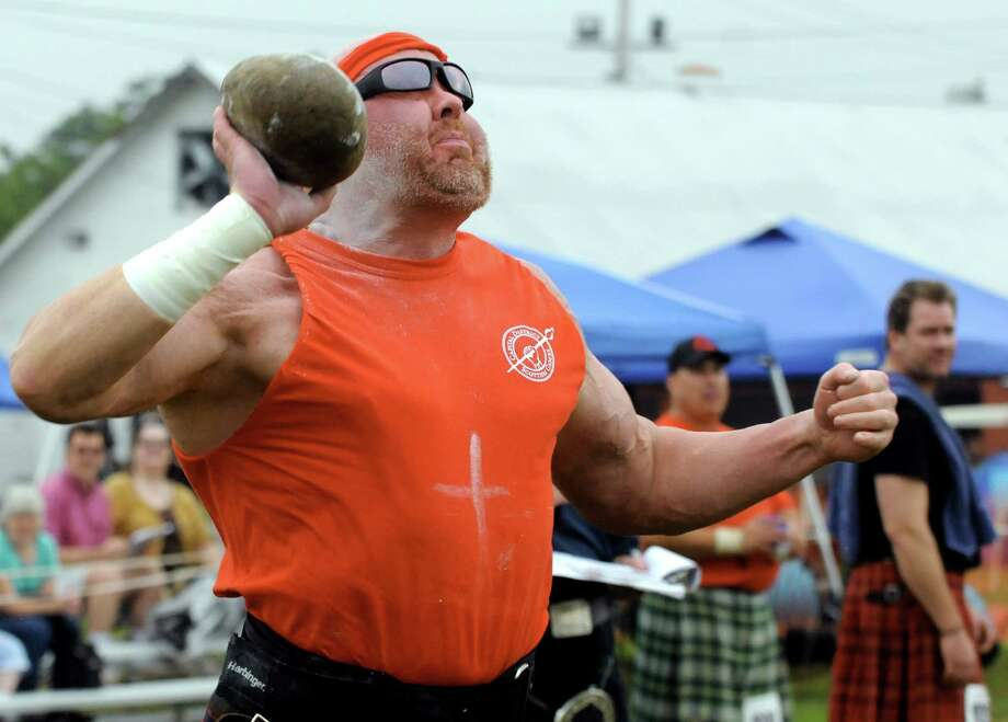 Dan Dillon of Mineola competes in the stone throw during the Capital District Scottish Games at the Altamont Fairgrounds on Saturday Aug. 31, 2013 in Altamont, N.Y. (Michael P. Farrell/Times Union) Photo: Michael P. Farrell / 00023699A
