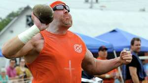 Dan Dillon of Mineola competes in the stone throw during the Capital District Scottish Games at the Altamont Fairgrounds on Saturday Aug. 31, 2013 in Altamont, N.Y. (Michael P. Farrell/Times Union)