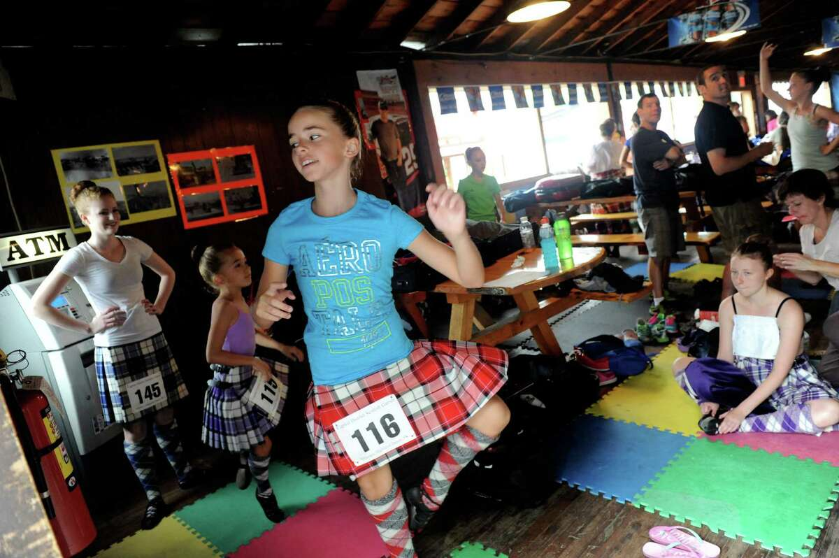 Eleven-year-old Elizabeth Wood, center, of Ontario, Canada practices her Highland dancing prior to competition during the Capital District Scottish Games at the Altamont Fairgrounds on Saturday Aug. 31, 2013 in Altamont, N.Y. (Michael P. Farrell/Times Union)