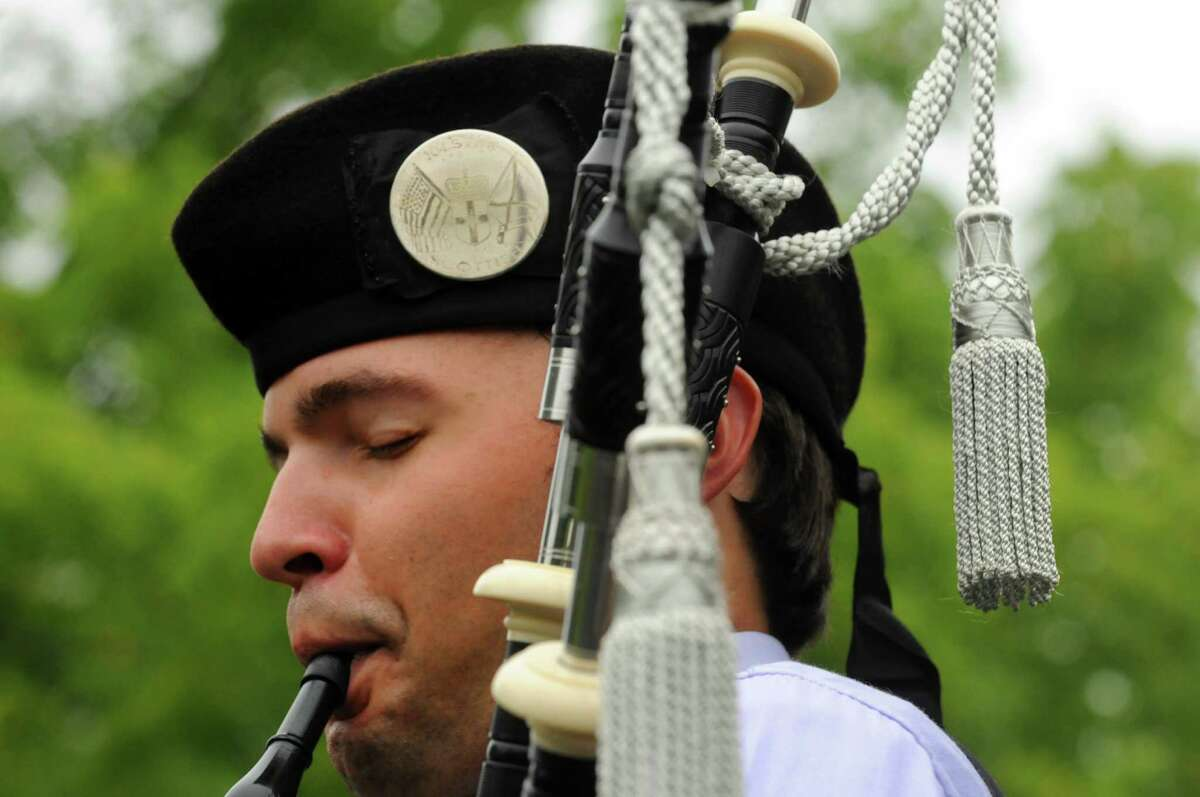 Matthew Cornetto of Ringoes,NJ plays the bagpipes with the Ulster Scottish Pipe Band during the Capital District Scottish Games at the Altamont Fairgrounds on Saturday Aug. 31, 2013 in Altamont, N.Y. (Michael P. Farrell/Times Union)