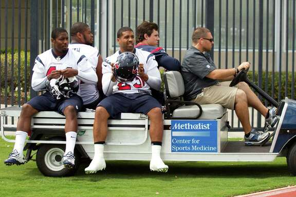 Houston Texans Ben Tate (44), Arian Foster (23) Wade Smith and Brian Cushing take a ride to practice during Texans' Organized Team Activities at the Methodist Training Center Monday, May 20, 2013, in Houston.