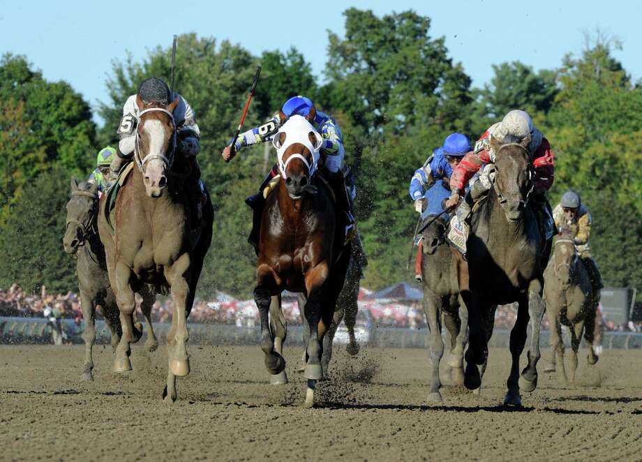Will Take Charge with jockey Luis Saez, left catches Moreno with jockey Jose Ortiz, center to win the 144th running of The Travers Stakes Aug 24, 2013, at the Saratoga Race Course in Saratoga Springs, N.Y. Third place was Orb with jockey Jose Lescano, right. (Skip Dickstein/Times Union) Photo: SKIP DICKSTEIN
