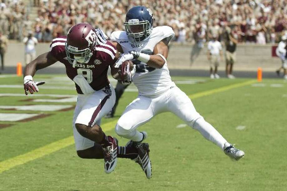 Texas A&M 52, Rice 31Record: 0-1  Texas A&M wide receiver Ricky Seals-Jones dives across the goal line with Rice cornerback Bryce Callahan on his back. Photo: Brett Coomer, Houston Chronicle