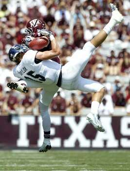 Rice wide receiver Jordan Taylor makes a catch against the Aggies. Photo: Brett Coomer, Houston Chronicle