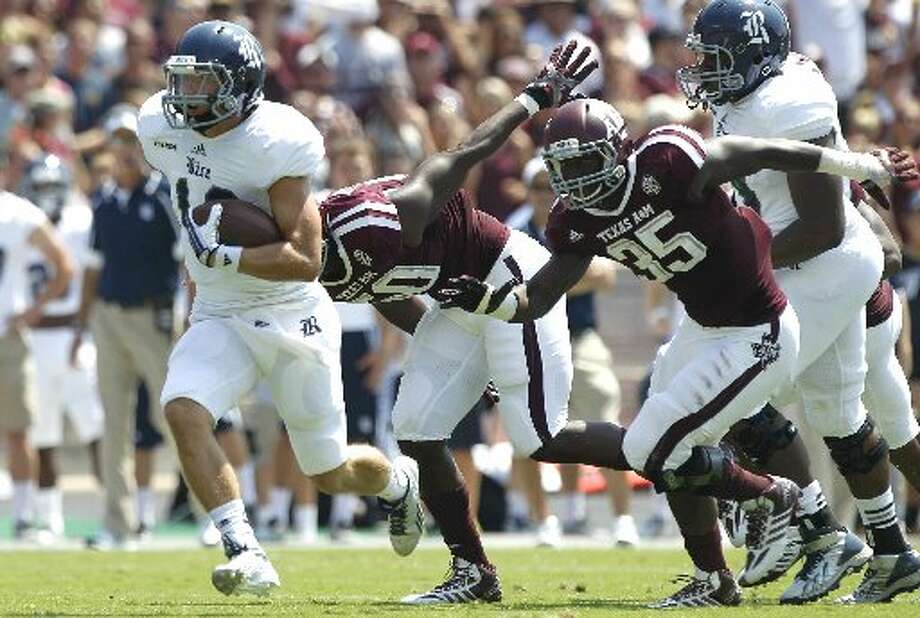 Rice quarterback Taylor McHargue rushes against Texaas A&M's defense. Photo: Brett Coomer, Houston Chronicle