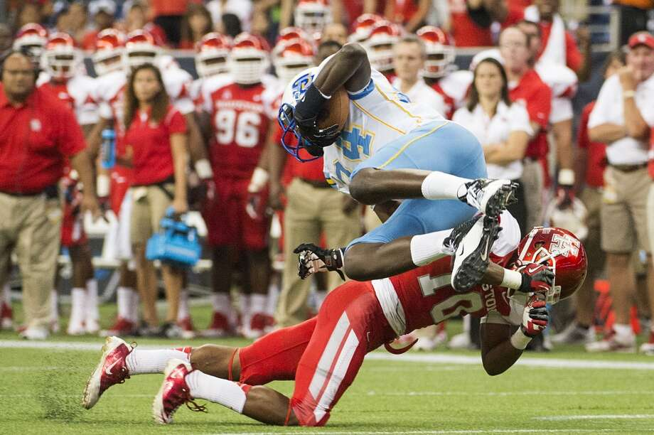 Aug. 30: Houston 62, Southern, 13Record: 1-0  Southern University tight end Bradley Coleman is upended by Houston defensive back Zachary McMillian during the first half. Photo: Smiley N. Pool, Houston Chronicle
