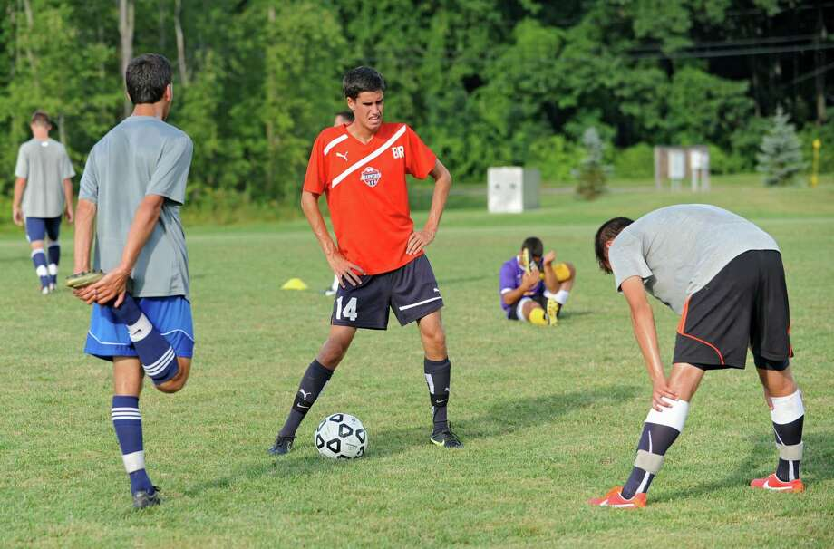 From left, Ethan Strauss, Ben Russell and Liam Martens chat while they stretch as the Bethlehem soccer team practices on Wednesday, Aug. 28, 2013 in Delmar, N.Y.  (Lori Van Buren / Times Union) Photo: Lori Van Buren / 00023663A