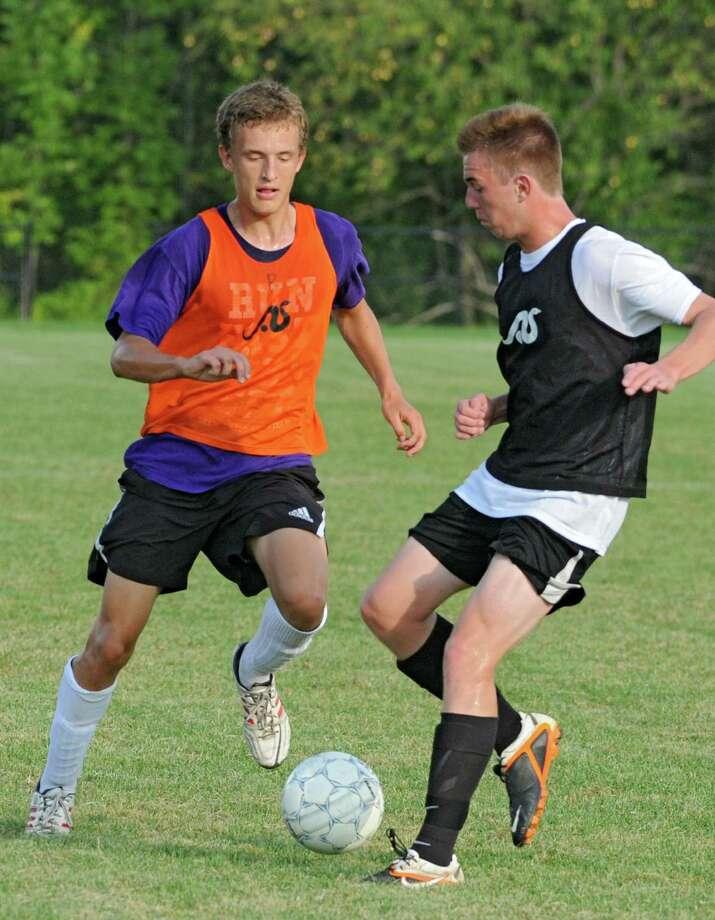 Matt Henning, left, and Brian Devane battle for the ball as the Bethlehem boys' soccer team practices on Wednesday, Aug. 28, 2013 in Delmar, N.Y.  (Lori Van Buren / Times Union) Photo: Lori Van Buren / 00023663A