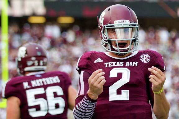 Texas A&M quarterback Johnny Manziel savors the moment after throwing one of his three touchdown passes during his second-half stint against Rice on Saturday at Kyle Field. Manziel later was penalized for unsportsmanlike conduct for taunting the Owls.