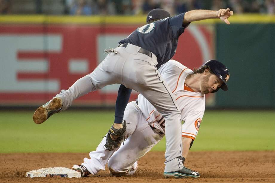 Aug. 31: Mariners 3, Astros 1Astros second baseman Jake Elmore is safe at second with a stolen base as Mariners second baseman Nick Franklin applies the tag late. Photo: Smiley N. Pool, Houston Chronicle