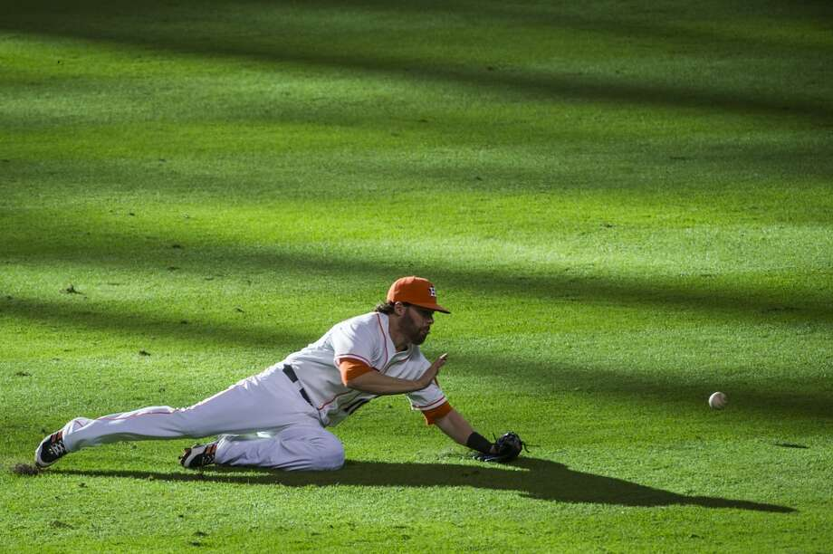 Astros second baseman Jake Elmore dives for a grounder off the bat of Mariners third baseman Kyle Seager. Photo: Smiley N. Pool, Houston Chronicle