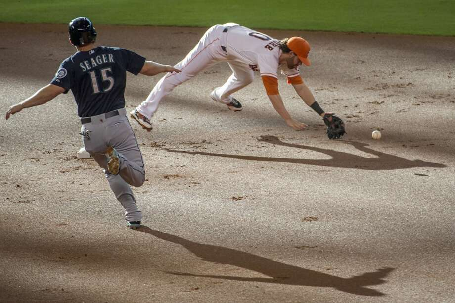 Mariners third baseman Kyle Seager is safe at second as the throw gets past Astros second baseman Jake Elmore. Photo: Smiley N. Pool, Houston Chronicle