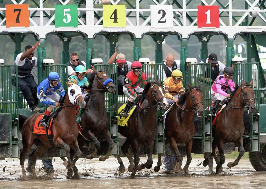 Alpha with jockey John Velazquez, left breaks the gate in the 60th running of The Woodward at the Saratoga Race Course in Saratoga Springs, N.Y.  (Skip Dickstein/Times Union) Photo: SKIP DICKSTEIN