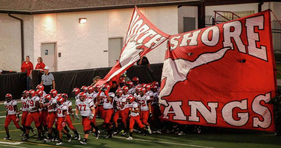 The North Shore Mustangs run onto the field following halftime in a high school football game at Veterans Memorial Stadium on Saturday, Aug. 31, 2013. in League City. Photo: Andrew Richardson, For The Chronicle / © 2013 Andrew Richardson