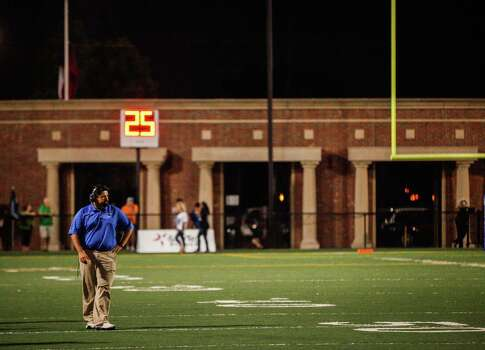 Clear Springs head coach Frank Maldonado stands on the field during the third quarter of a high school football game at Veterans Memorial Stadium on Saturday, Aug. 31, 2013. in League City. Photo: Andrew Richardson, For The Chronicle / © 2013 Andrew Richardson