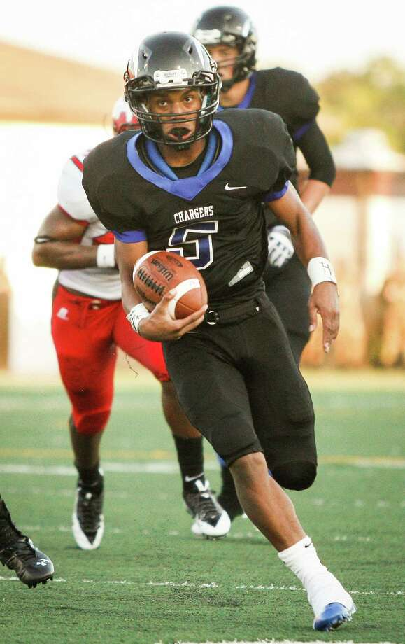 Clear Springs running back Matt Guidry (5) carries the ball for a touchdown during the second quarter of a high school football game at Veterans Memorial Stadium on Saturday, Aug. 31, 2013. in League City. Photo: Andrew Richardson, For The Chronicle / © 2013 Andrew Richardson