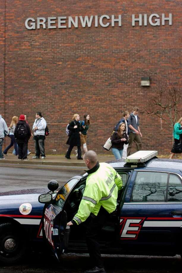 Police patrol outside Greenwich High School in this 2007 file photo. Photo: File Photo / Greenwich Time File Photo