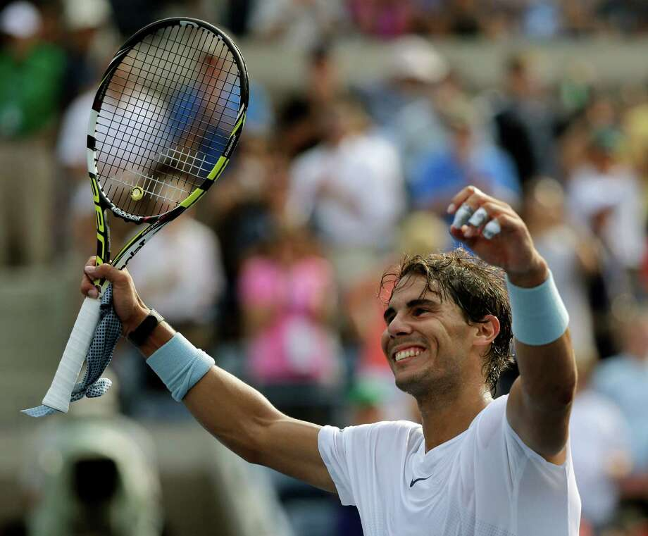 Second-seeded Rafael Nadal defeated Ivan Dodig 6-4, 6-3, 6-3 in the third round Saturday. Photo: Mike Groll, STF / AP