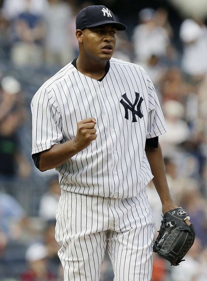New York Yankees' Ivan Nova reacts after Baltimore Orioles' Chris Davis hits a fly out during the ninth inning of a baseball game Saturday, Aug. 31, 2013, in New York.The Yankees won the game 2-0. (AP Photo/Frank Franklin II) Photo: Frank Franklin II, Associated Press
