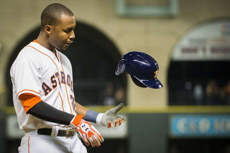 Astros outfielder L.J. Hoes tosses his helmet after grounding out for the final out of the game. Photo: Smiley N. Pool, Houston Chronicle