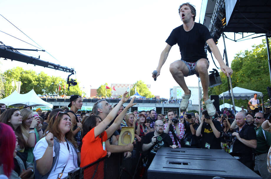 Nick Offer of the band !!! (Chk Chk Chk) jumps on a speaker at the Fisher Green Stage during the first day of Bumbershoot on Saturday, August 31, 2013. Photo: JOSHUA TRUJILLO, SEATTLEPI.COM / SEATTLEPI.COM