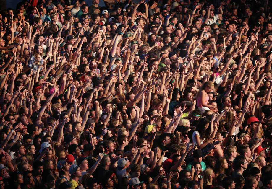 Fans cheer as Kendrick Lamar performs in KeyArena during the first day of Bumbershoot on Saturday, August 31, 2013. Photo: JOSHUA TRUJILLO, SEATTLEPI.COM / SEATTLEPI.COM