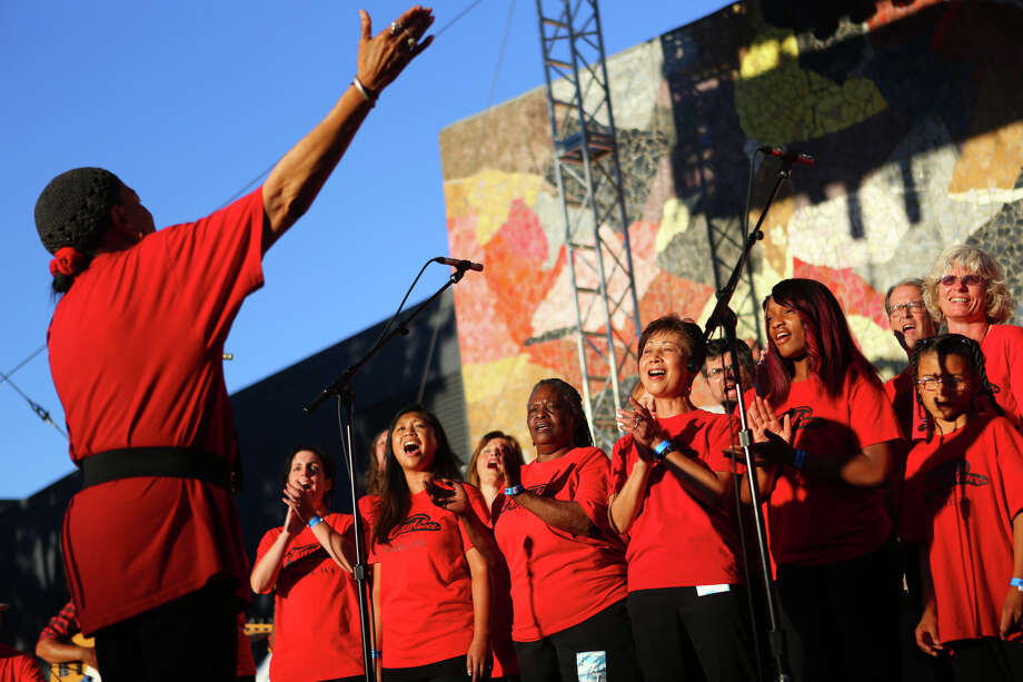 Member of the Total Experience Gospel Choir perform at the Mural Amphitheater during the first day of Bumbershoot on Saturday, August 31, 2013. Photo: JOSHUA TRUJILLO, SEATTLEPI.COM / SEATTLEPI.COM