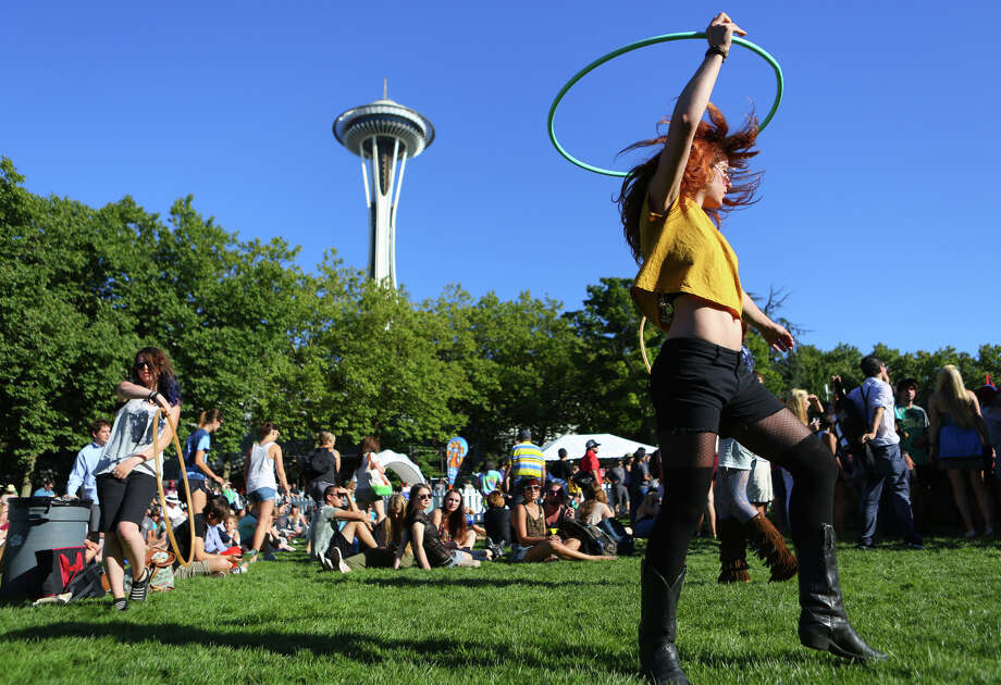 Danielle Dent dances with a hula hoop during the first day of Bumbershoot on Saturday, August 31, 2013. Photo: JOSHUA TRUJILLO, SEATTLEPI.COM / SEATTLEPI.COM