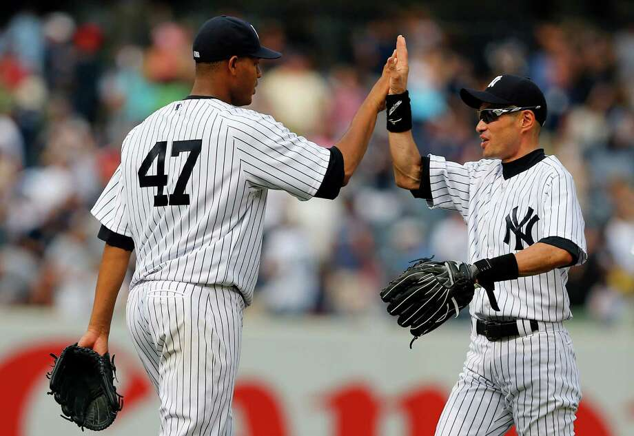 Ivan Nova, left, and Ichiro Suzuki helped the Yankees pull ahead of Baltimore in the wild-card race. Photo: Rich Schultz, Stringer / 2013 Getty Images