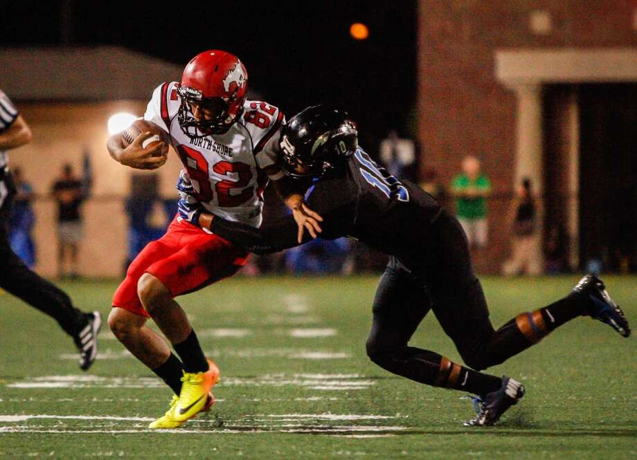 North Shore linebacker Chris Colquitt (32) is tackled by Clear Springs player Tevin Dent (10) after recovering a bad snap during the third quarter of a high school football game at Veterans Memorial Stadium on Saturday, Aug. 31, 2013. in League City.   ( Andrew Richardson / For the Chronicle ) Photo: Andrew Richardson, For The Chronicle
