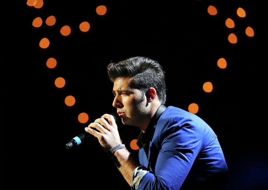 Jencarlos Canela performs Saturday Aug. 31, 2013 during  Festival People en Espanol at the Illusions Theater in the Alamodome. Photo: Edward A. Ornelas, San Antonio Express-News / © 2012 San Antonio Express-News