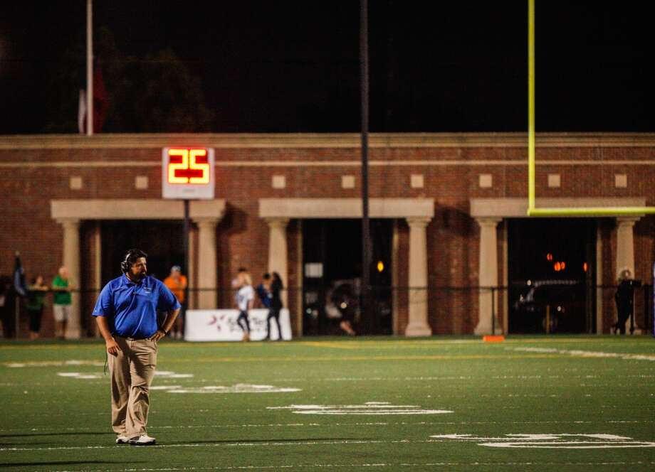 Clear Springs head coach Frank Maldonado stands on the field during the third quarter of a high school football game at Veterans Memorial Stadium on Saturday, Aug. 31, 2013. in League City.   ( Andrew Richardson / For the Chronicle ) Photo: Andrew Richardson, For The Chronicle