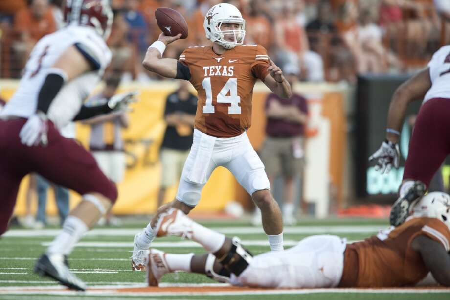 UT 56, NMSU 7Record: 1-0  David Ash #14 of the Texas Longhorns throws a pass against the New Mexico State Aggies. Photo: Cooper Neill, Getty Images