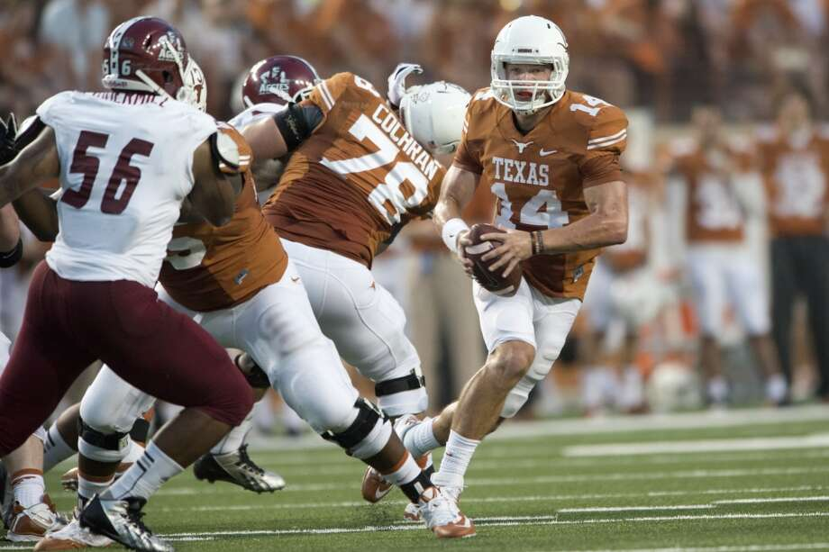 David Ash #14 of the Texas Longhorns scrambles against the New Mexico State Aggies. Photo: Cooper Neill, Getty Images
